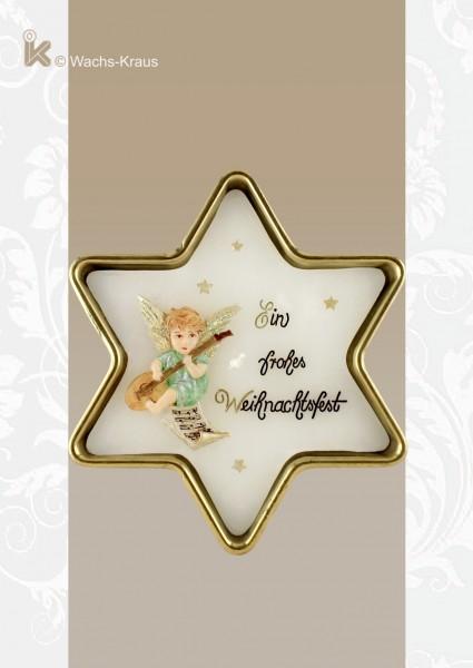 Sternförmige Weihnachtskerze in einer Messing-Schale. Das Motiv: ein Laute spielender Engel und der Text: ein frohes Weihnachtsfest